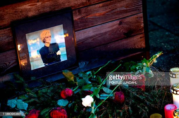 Flowers and a photo are placed at a makeshift memorial for Swedish pop singer and songwriter Marie Fredriksson outside Baggpipe Studios in...