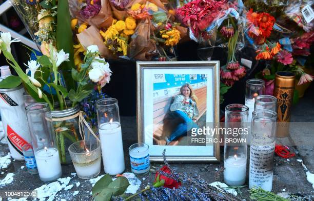Flowers and a photograph are seen at a memorial for Melyda Corado the assistant manager at the Silver Lake Trader Joe's who was killed in a July 21...