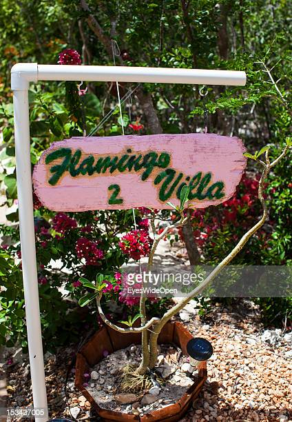 Flowers and a pink sign Flamingo Villa of a hotel on June 15, 2012 in Long Island, The Bahamas.