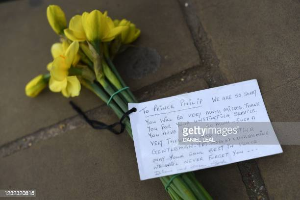 Flowers and a tribute are pictured outside Buckingham Palace in central London, on April 15 following the April 9 death of Britain's Prince Philip,...