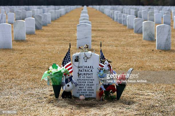 Flowers and American flags sit at the gravesite of fallen Navy SEAL Lt Michael Murphy at Calverton National Cemetery near Riverhead LI Murphy will...