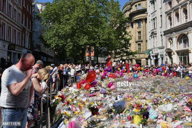 Flowers and balloons are left in Saint Ann's Square in tribute to those killed in an explosion at the Manchester Arena earlier this week on May 26...