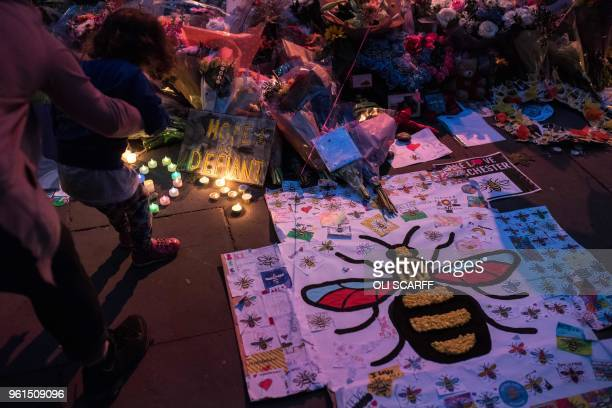 Flowers and balloons are placed in central Manchester on May 22 the one year anniversary of the deadly attack at Manchester Arena. - Prime Minister...
