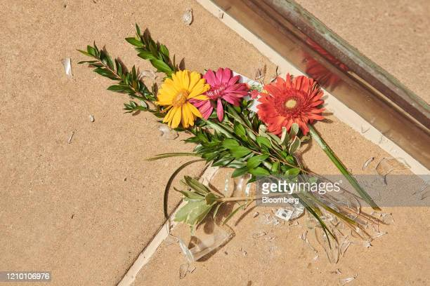 Flowers and broken glass lay on the ground outside the Cathedral of Saint Joseph in Sioux Falls South Dakota US on Wednesday April 15 2020 South...