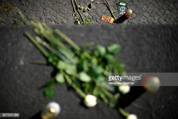 Flowers and candles are laid down outside HDI Arena in memory of Niklas Feierabend on May 2 2016 in Hanover Germany The 19year old Niklas Feierabend...