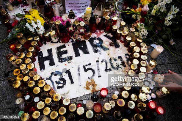 Flowers and candles are placed at a makeshift memorial as thousands of Slovaks rally in Bratislava Slovakia on June 8 2018 to pay tribute to murdered...