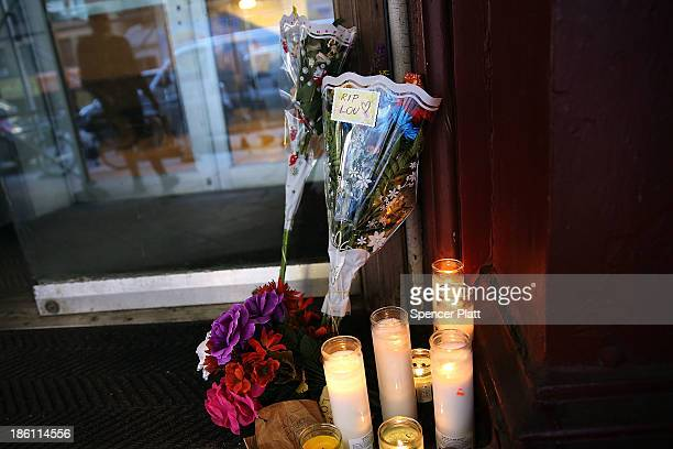 Flowers and candles are placed at the entrance to the Chelsea Hotel in memory of musician Lou Reed on October 28, 2013 in New York City. Lou Reed,...