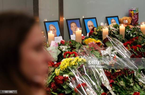 Flowers and candles are placed in front of the portraits of the victims of flight PS 752 at the memorial corner of Boryspil International Airport...