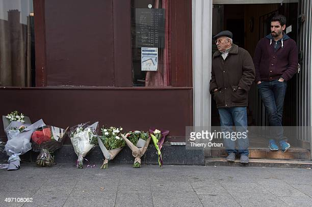 Flowers and candles are placed in tribute outside le carillon and le petit cambodgien bars the day after a deadly attack on November 14 2015 in Paris...