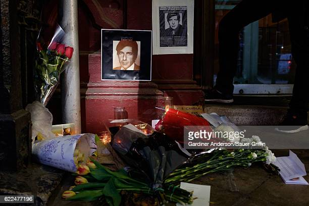 Flowers and candles are seen at a makeshift memorial to Leonard Cohen outside the Chelsea Hotel on November 11, 2016 in New York City.