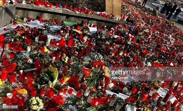Flowers and candles are seen outside Albertville high school on March 21 2009 in Winnenden near Stuttgart Germany 17 year old Tim Kretschmer opened...