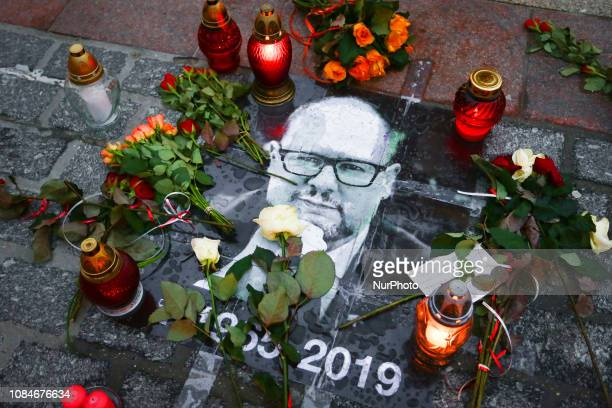 Flowers and candles commemorating Pawel Adamowicz at the Main Square in Krakow, Poland on January 18, 2019. Pawel Adamowicz, Mayor of Gdansk, was...