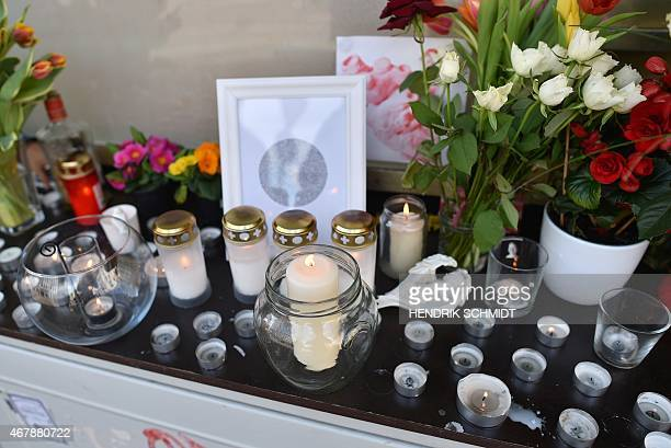 Flowers and candles have been left to commemorate a woman a victim of the Germanwings plane crash from Halle eastern Germany on March 28 2015 French...