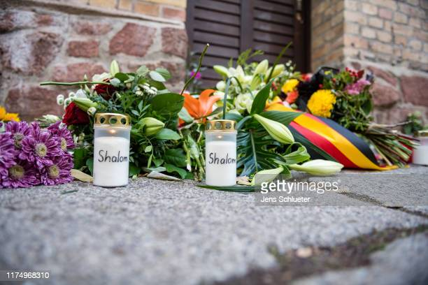 Flowers and candles in front the Jewish synagogue on October 10 2019 in Halle Germany Law enforcement authorities after initially speaking of...