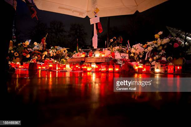 Flowers and candles lie at a makeshift memorial at Alexanderplatz to Jonny K who was beaten to death nearby three weeks ago on November 4 2012 in...