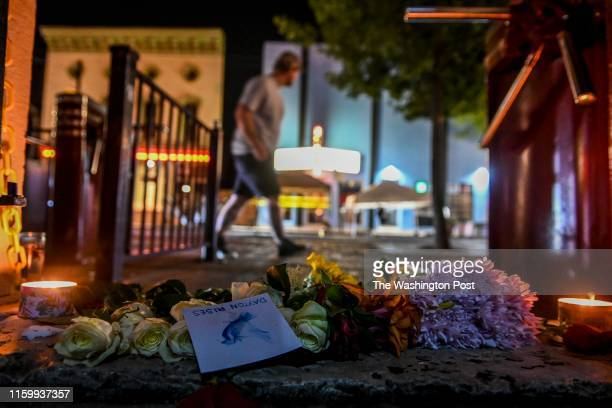 """Flowers and candles mark the scene of a mass shooting in the city's historic Oregon District where Connor Betts used an """"AR-15-like"""" rifle about 24..."""