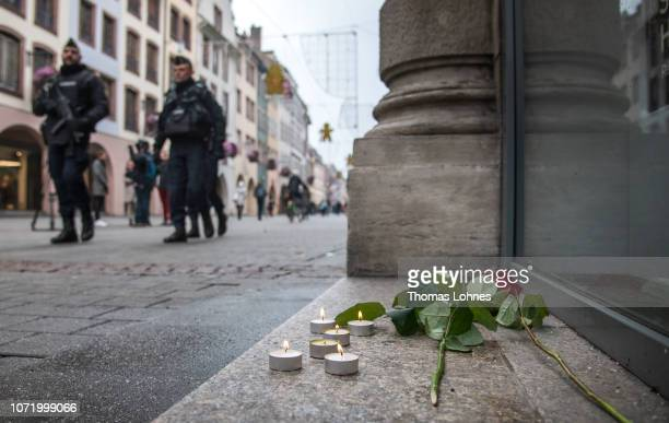 Flowers and candles pictured near the Christmas market where the day before a man shot 14 people killing at least three on December 12 2018 in...