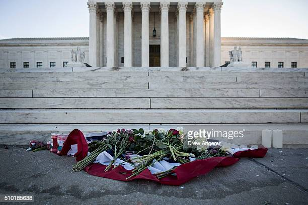 Flowers and candles sit at the bottom of the steps at the US Supreme Court following the death of Supreme Court Justice Antonin Scalia February 14...