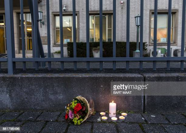 Flowers and candles stand outside The International Criminal Tribunal for the former Yugoslavia at The Hague The Netherlands on November 29 after the...