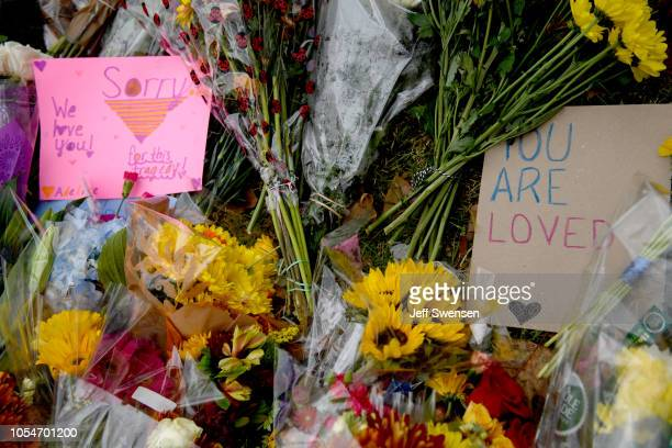Flowers and cards sit at a makeshift memorial down the street from the site of the mass shooting that killed 11 people and wounded 6 at the Tree Of...