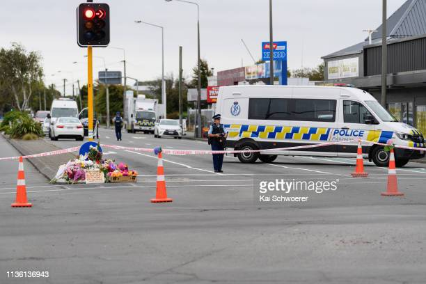 Flowers and condolences are seen in front of a police cordon on Linwood Avenue near Linwood mosque on March 16 2019 in Christchurch New Zealand At...