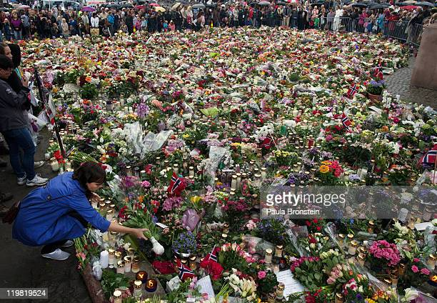 Flowers and condolences surround the outside of Oslo Cathedral after Anders Behring Breivik appeared in a closed court on July 25 2011 in Oslo Norway...