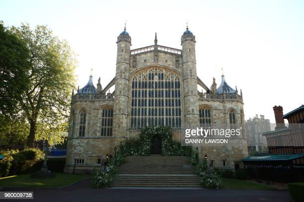 Flowers and foliage adorn the West door and steps of St George's Chapel for the wedding ceremony of Britain's Prince Harry and US actress Meghan...