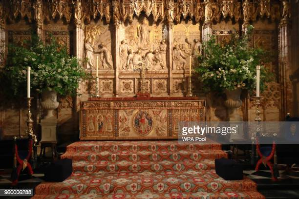 Flowers and foliage surround the High Altar of St George's Chapel at Windsor Castle for the wedding of Prince Harry to Meghan Markle on May 19 2018...