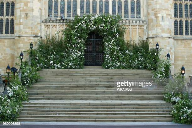 Flowers and foliage surround the West Door and steps of St George's Chapel at Windsor Castle for the wedding of Prince Harry to Meghan Markle on May...