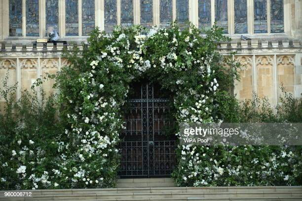Flowers and foliage surround the West Door of St George's Chapel at Windsor Castle for the wedding of Prince Harry to Meghan Markle on May 19 2018 in...