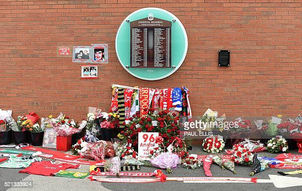 Flowers and football scarves lay in front of the temporary Hillsborough memorial ahead of a memorial service at Anfield in Liverpool north west...