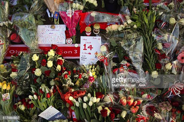 Flowers and gifts are left outside the house where Dutch football legend Johan Cruyff grew up after he died yesterday aged 69 in Barcelona on March...