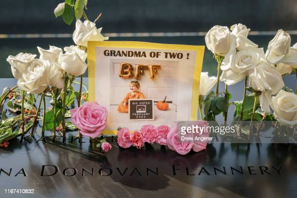 Flowers and mementos are left at the National September 11 Memorial on the 18th anniversary of the 9/11 attacks September 11 2019 in New York City...
