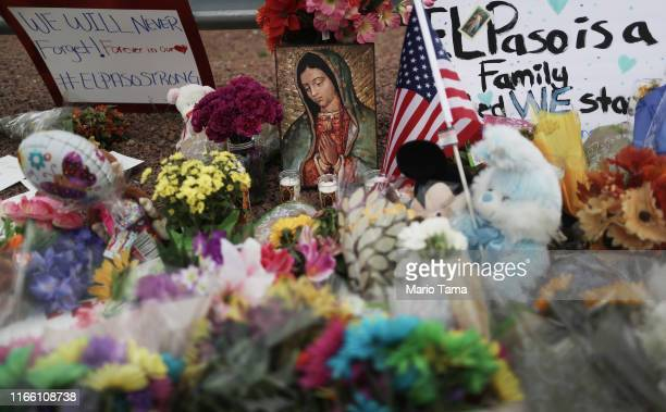 Flowers and mementos are seen at a makeshift memorial outside Walmart near the scene of a mass shooting which left at least 20 people dead on August...