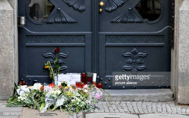 Flowers and memorial candles outside the entrance to the Unister company headquarters in Leipzig Germany 18 July 2016 The Leipziger internet company...