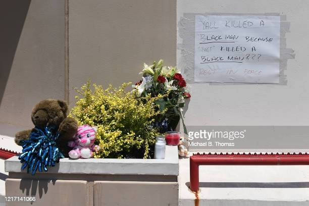 Flowers and messages are left at a memorial for David Dorn a 77yearold retired police captain who was murdered during overnight rioting outside Lee's...