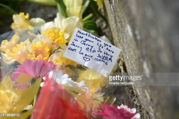 Flowers and messages are left in tribute to journalist Lyra McKee near the scene of her shooting on April 19 2019 in Londonderry Northern Ireland...