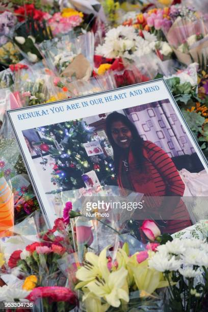 Flowers and messages at a memorial during an interfaith vigil at Nathan Phillips Square in memory of the 10 people killed and 15 people injured in a...