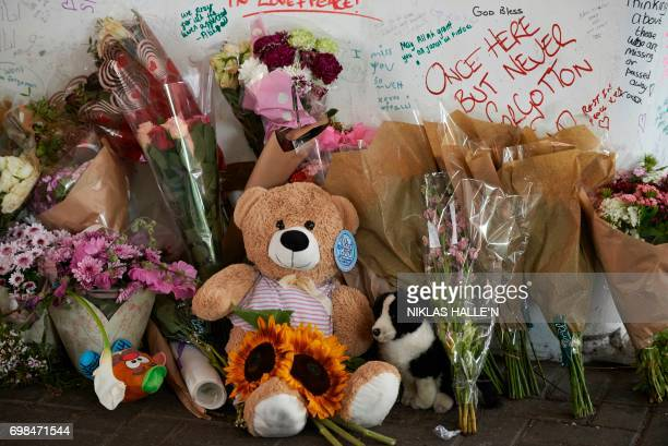 Flowers and messages left by wellwishers in tribute to the victims of the Grenfell Tower block are seen near the scene of the fire in North...