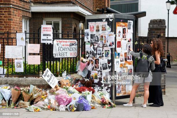 Flowers and messages left by wellwishers in tribute to the victims of the June 14 Grenfell Tower block fire are pictured near the scene of the fire...