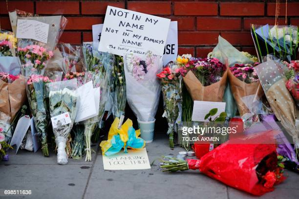 Flowers and messages left outside Finsbury Park Mosque are seen in the Finsbury Park area of north London on June 20 following a van attack on...