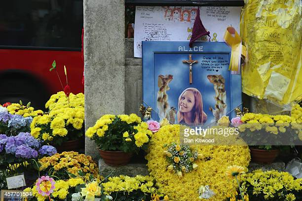 Flowers and messages of condolance besides the clock tower in Hanwell ahead of the funeral for murdered teenager Alice Gross on October 23 2014 in...