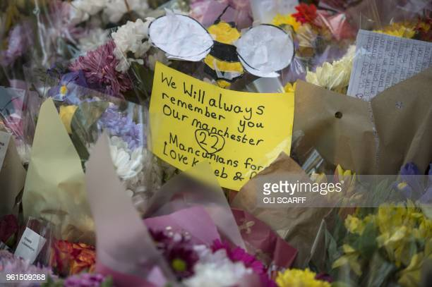 Flowers and messages of condolence are left in central Manchester, May 22 marking the one year anniversary of the deadly attack at Manchester Arena....