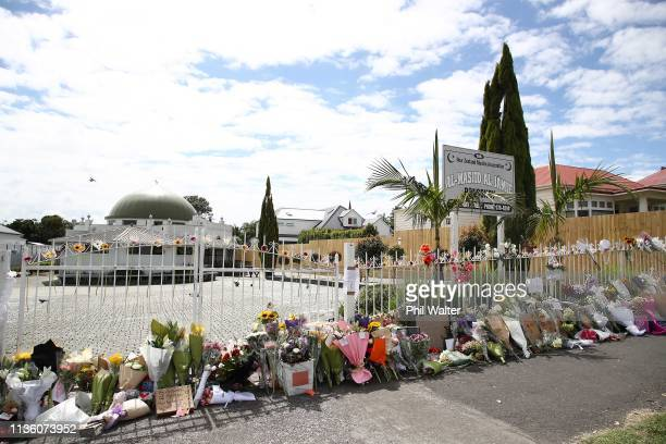 Flowers and messages of condolence are left outside the Ponsonby mosque on March 16 2019 in Auckland New Zealand At least 49 people are confirmed...