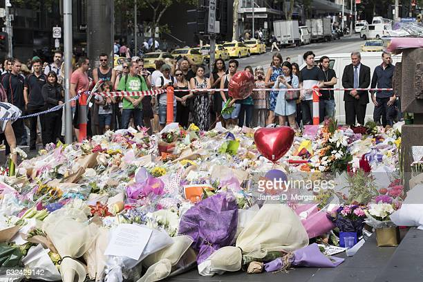 Flowers and messages of condolence lie on Bourke Street Mall on January 23 2017 in Melbourne Australia Five people including an infant were killed...