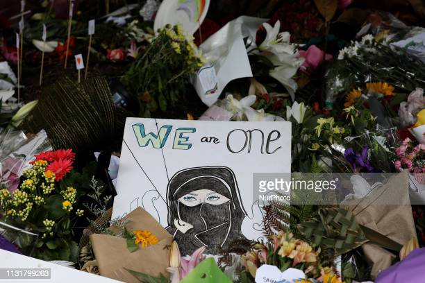Flowers and messages of condolence to victims of the mosque attacks are seen at a memorial outside the Masjid Al Noor mosque in Christchurch New...