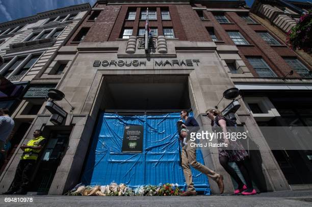 Flowers and messages of support are seen outside a closed entrance to Borough Market on June 11 2017 in London England After the terror attack on...