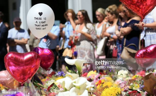Flowers and messages of support rest in St Ann's Square in Manchester northwest England on May 26 placed in tribute to the victims of the May 22...