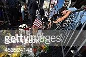 Flowers and momentos are left at a makeshift memorial to Robin Williams at his star on the Hollywood Walk of Fame August 12 in Hollywood California...