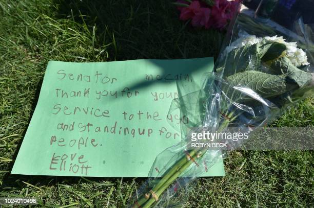 Flowers and notes are placed in tribute to US Senator John McCain outside a mortuary in Phoenix Arizona August 26 after the twotime presidential...